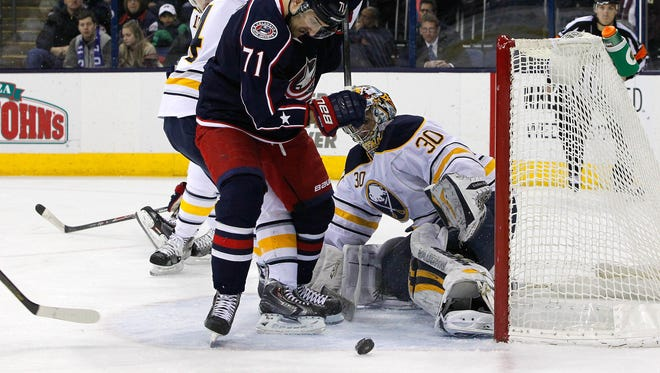 Buffalo Sabres goalie Ryan Miller (30) makes a save as Columbus Blue Jackets left wing Nick Foligno (71) goes after the rebound during the second period at Nationwide Arena.