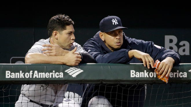 New York Yankees' Jacoby Ellsbury, left, and Alex Rodriguez stand in the dugout during a baseball game against the Baltimore Orioles in Baltimore, Thursday, May 5, 2016.