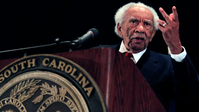 FILE- In this Feb. 13, 2012 file photo, Judge Ernest Finney, Jr., speaks during a ceremony for the 2012 inductees into the South Carolina Hall of Fame in Myrtle Beach, S.C. Judge Ernest Finney, Jr., the first African American Chief Justice of the South Carolina Supreme Court since Reconstruction, died Sunday, Dec. 3, 2017. He was 86. (AP Photo/The Sun News, Steve Jessmore, File)