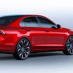 VW's 'midsize coupe concept' is on display at the Beijing auto show, evoking the look of the Passat-size CC. It's shorter than a Jetta, but wider than a Passat -- sort of a Jetta CC.