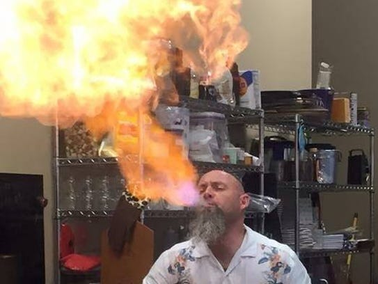 Paul Ayo is known for his fire-blowing skills.