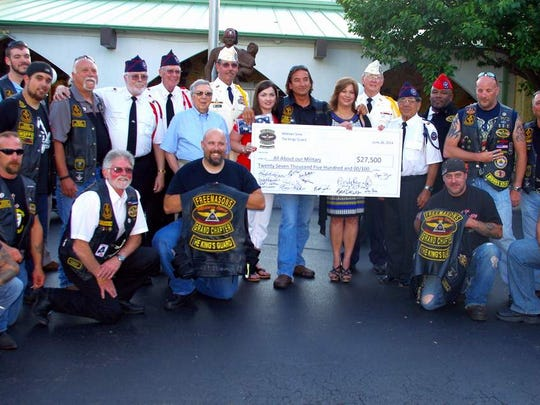 Andy Reynolds (with check) poses with those who helped with the benefit and representatives from the organizations which benefited.