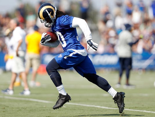 Los Angeles Rams running back Todd Gurley carries the ball during the NFL football team's training camp, Saturday, July 30, 2016, in Irvine, Calif. (AP Photo/Ryan Kang)