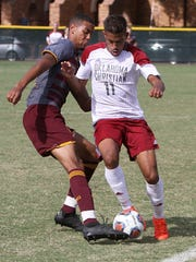 Lauren Roberts/Times Record NewsMidwestern State's Jordan Speed forces Oklahoma Christian's Anthony Buchanan to lose the ball out of bounds Saturday, Oct. 29, 2016, at the MSU Soccer Field. The Mustangs won the final match of the regular season 4-1.