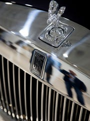 A one-of-a-kind Rolls-Royce Phantom is admired by potential bidders and other guests during an open house event at Rolls-Royce of Naples Thursday, Dec. 14, 2017 in Naples. The car will be available for auction at the Naples Winter Wine Festival.