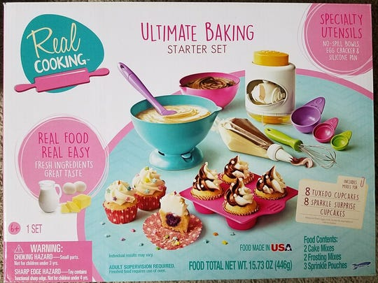 Real Cooking - Baking Starter Set comes with bowls, an egg cracker (!), mixes and recipes to bake more cupcakes than you should eat in one sitting.