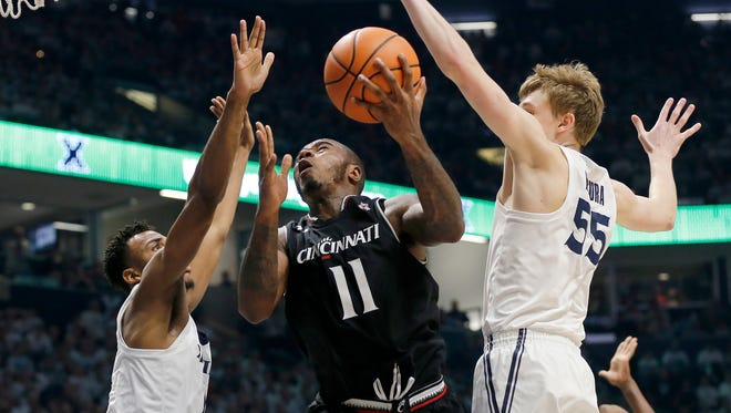 Cincinnati Bearcats forward Gary Clark (11) is stuffed as he attempts a layup in the second half of the 85th Annual Crosstown Shootout game between the Xavier Musketeers and the Cincinnati Bearcats at the Cintas Center in Cincinnati on Saturday, Dec. 2, 2017. The Musketeers won't the annual crosstown rivalry game, 89-76, dealing UC its first loss of the season.