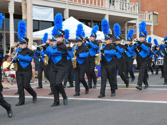 A number of local marching bands take part in the Parada