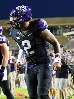 TCU Horned Frogs quarterback Trevone Boykin (2) celebrates his touchdown run against the West Virginia Mountaineers during the first quarter of a game at Amon G. Carter Stadium.