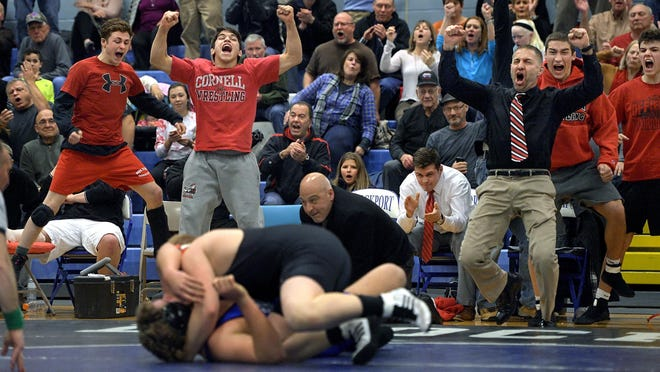 Hilton coach Craig Gross, right, and his bench erupt after Donald Neuffer pinned Brockport's Mike Mattison in the first period in the 285-pound weight class during a regular season meet held at A.D. Oliver Middle School on Wednesday, Jan. 27, 2016. Hilton beat Brockport 42-26.