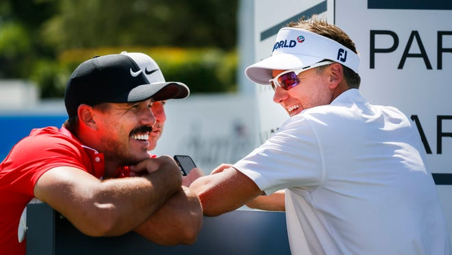 Brooks Koepka and Ian Poulter laugh as they wait to play the 10th hole during a practice round for the Charles Schwab Challenge golf tournament at Colonial Country Club. Mandatory Credit: Raymond Carlin III-USA TODAY Sports