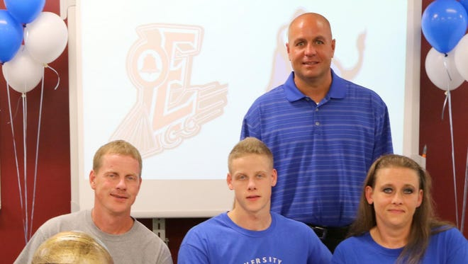 Tyler Moffe, center, is flanked by his dad, Todd Moffe, and mom, Yalanda Cady, during Tuesday's ceremony at Elmira High School. In the back is Express head coach Ryan Johnson.