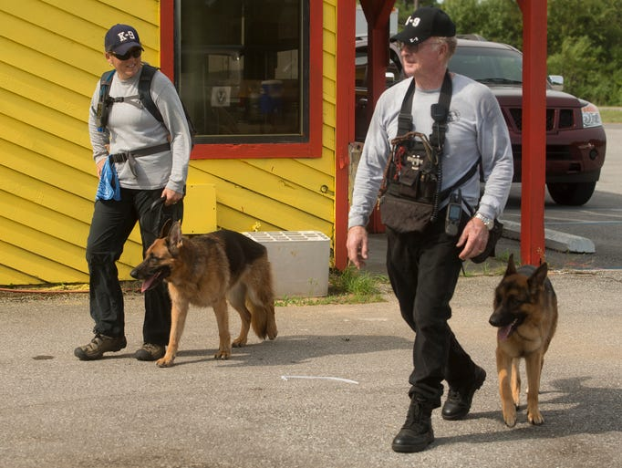 Gulf Coast Search and Recovery K-9 searcher, Shawn and George Felt, work with dogs Leibe and Gabe, look for clues to find a missing Pensacola man last seen in the area off Blue Angels Pkwy Monday morning Aug. 25, 2014.