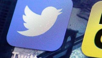 A Twitter app on an iPhone screen.