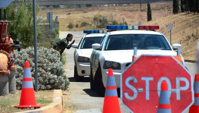 Border Patrol officers guard the U.S. Border Patrol facility in Murrieta, California on July 3, 2014.