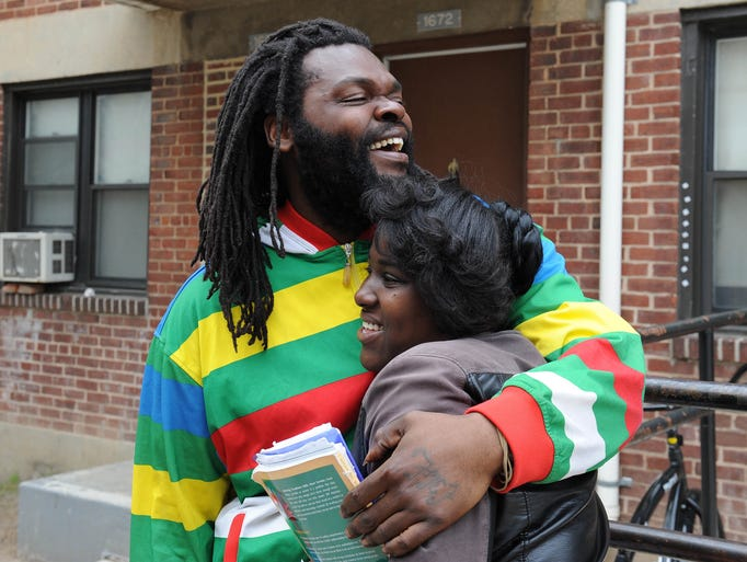 Kevin Moore hugs a woman identified only as Kiona in