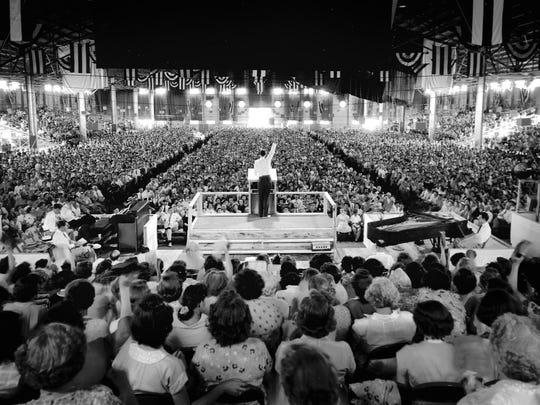 Billy Graham speaks to a crowd of 10,500 at the Fairgrounds Arena in Memphis, Tenn. on Sunday, June 3, 1951.