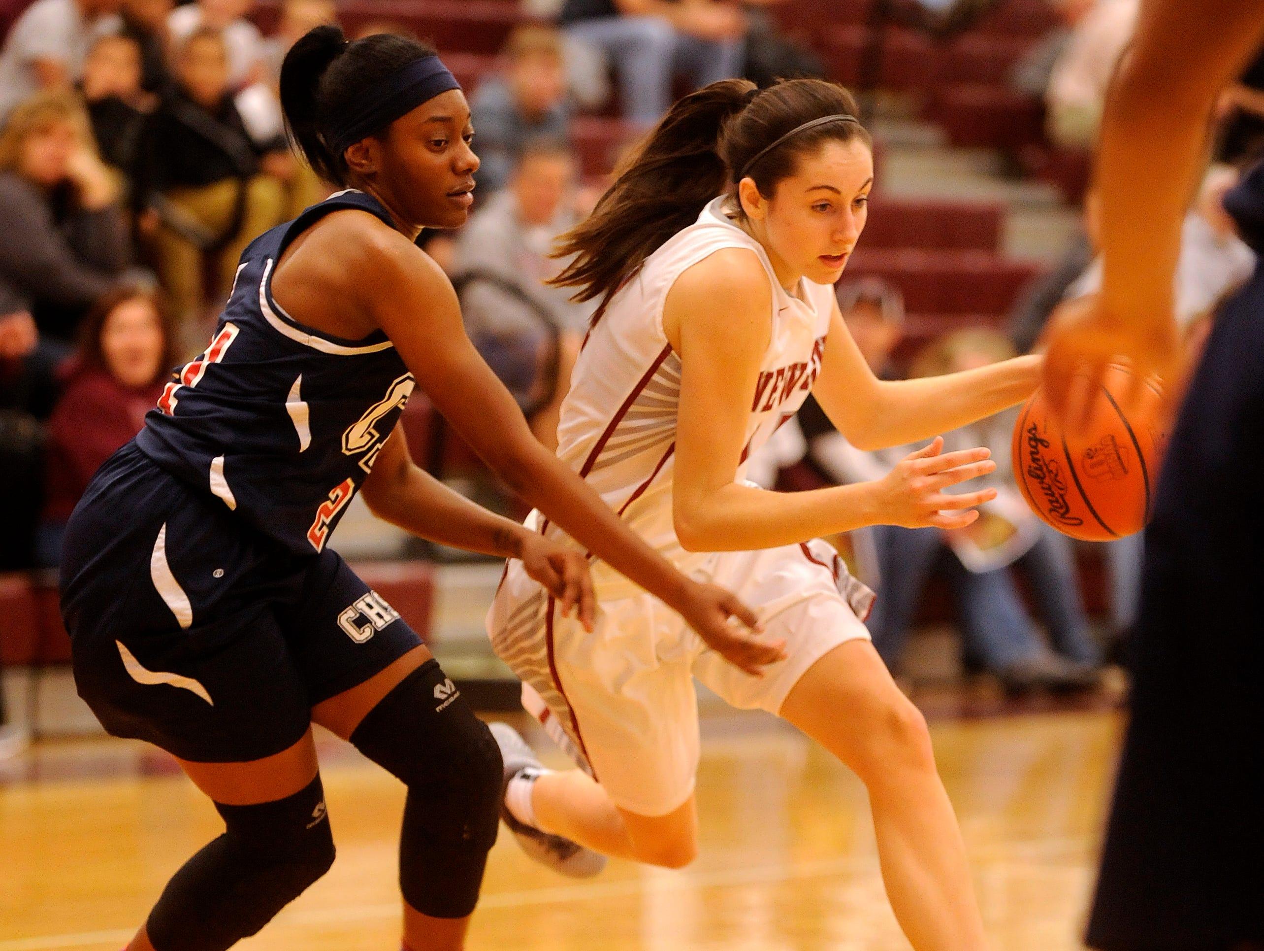 Newark's Katie Shumate dodges Centennial defenders Akiya Brown during an OHSAA Foundation Games on Tuesday, Nov. 17, 2015.