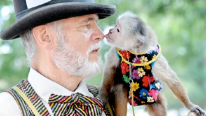 Jerry Brown, aka The Monkey Man, performs with his monkey, Django.