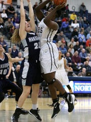Rutgers Prep takes on Manasquan in the 2016 Girls Tournament of Champions basketball game at the Pine Belt Arena in Toms River on Friday March 18, 2016.