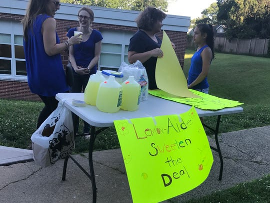 "A lemonade stand asks to ""sweeten the deal"" at a rally"