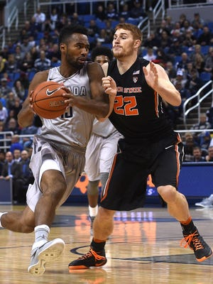 Nevada's D.J. Fenner takes the ball to the time during a game against Oregon State earlier this season.