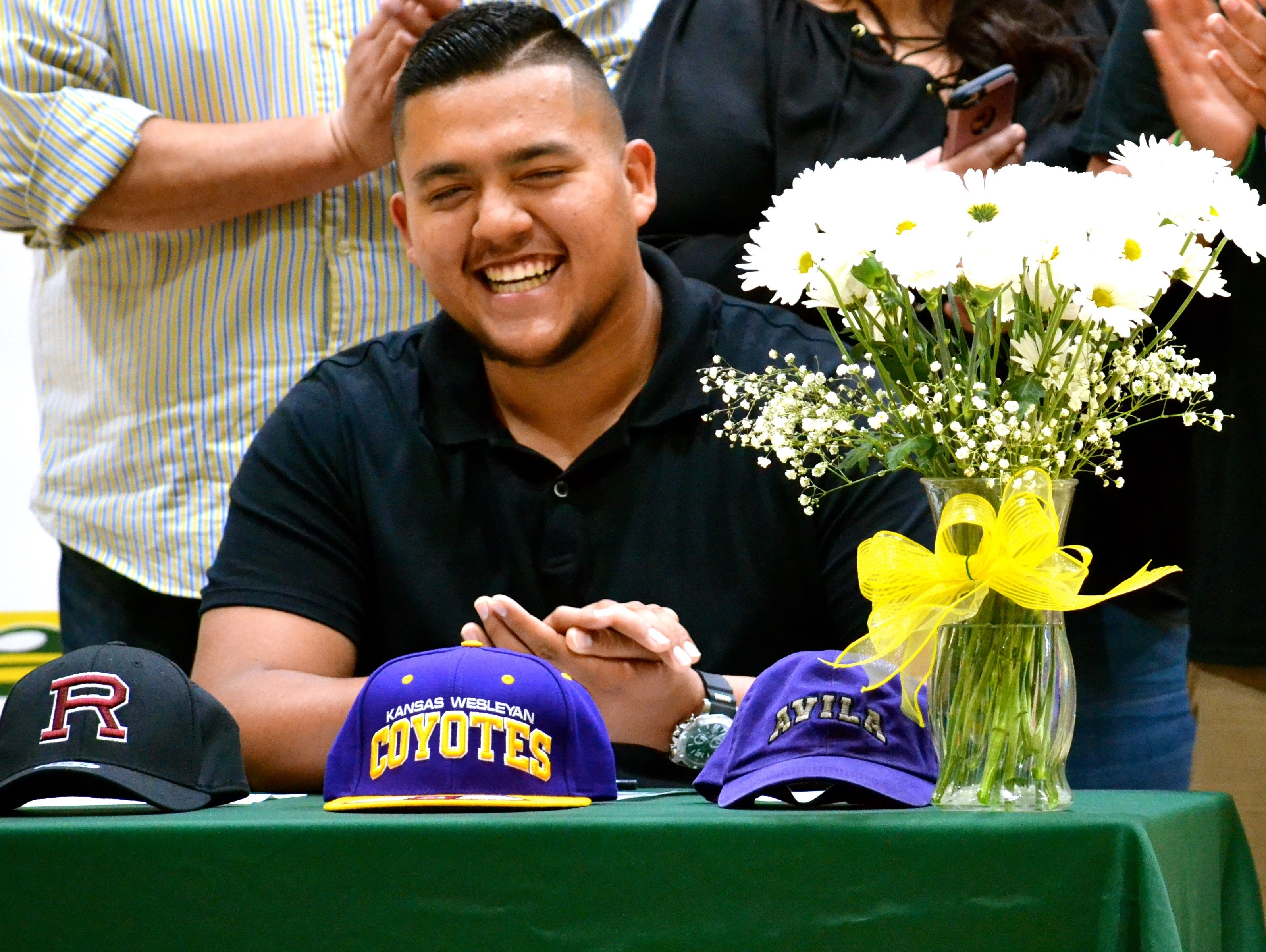 Coachella Valley senior offensive lineman Nick Hernandez celebrates during his national letter of intent signing ceremony.