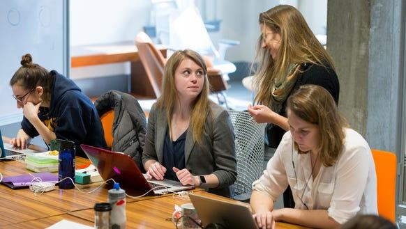 Staff members of REV Ithaca Startup Works meet in the
