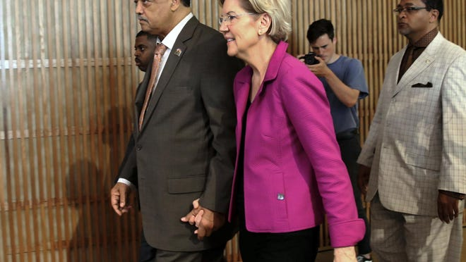 Rev. Jesse Jackson walks with Sen. Elizabeth Warren as the presidential candidate attends the Rainbow PUSH Coalition International Convention at Apostolic Faith Church in Chicago Saturday June 29, 2019.   Kevin Tanaka/For the Sun Times