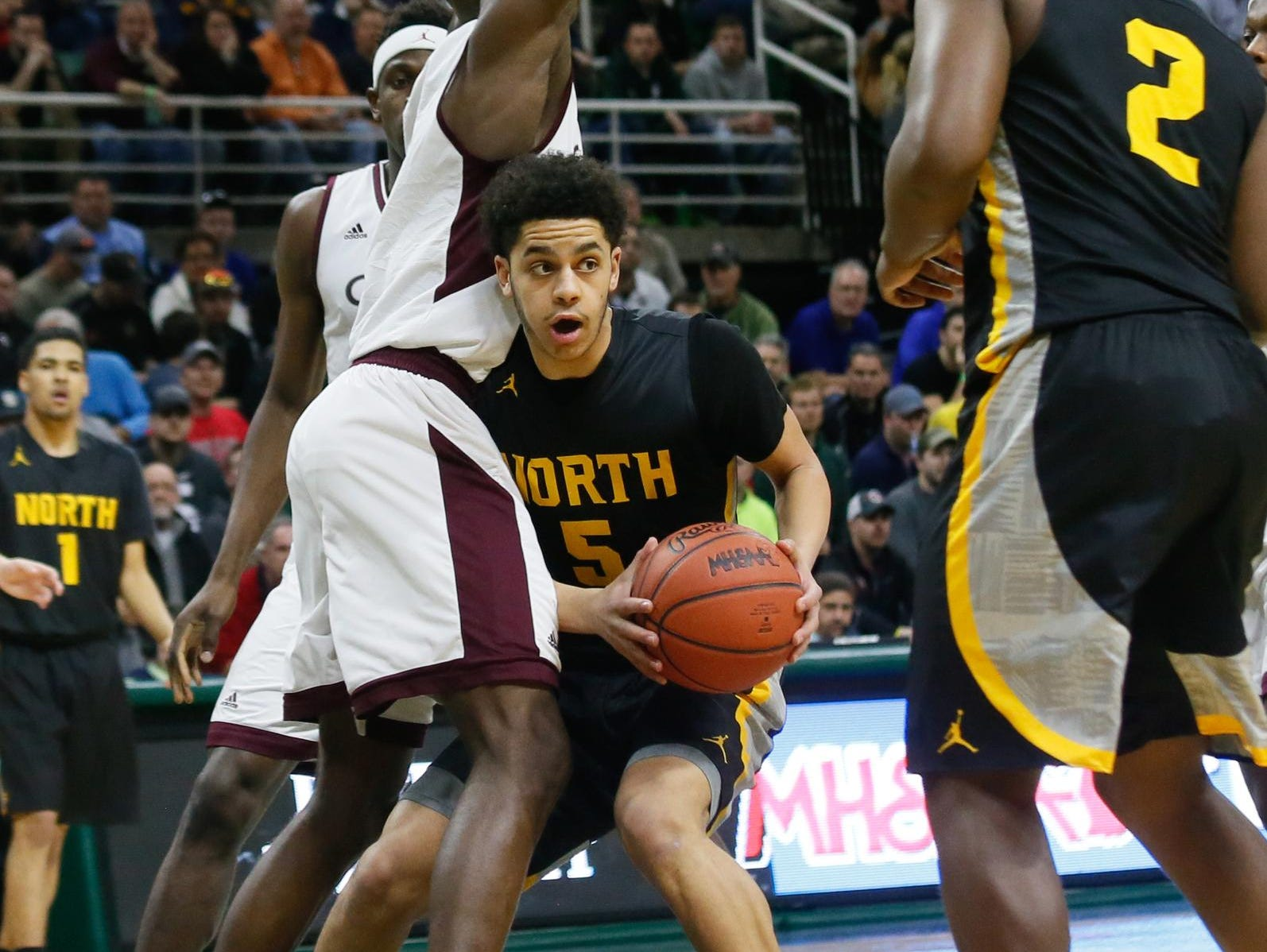North Farmington's Jacob Joubert looks to pass the ball Saturday. His father, Antoine Joubert, also played in the state finals.