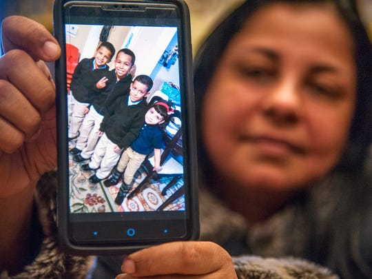 Elba Ramos of Camden displays a photo of her grandchildren from Puerto Rico who came to live with her after being displaced by Hurricane Maria.  The children now attend the Veteran's Memorial School in Camden.  12.13.17