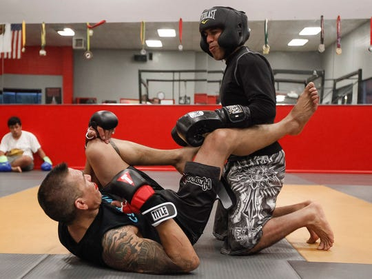 MMA coach Henry Cortez, bottom, spars with Jose Chavarin during a practice session at Fighterz Corner on Wednesday, May 3, 2017 in Salinas, Calif. The fighters are conditioning for an upcoming event. Vernon McKnight/for The Californian