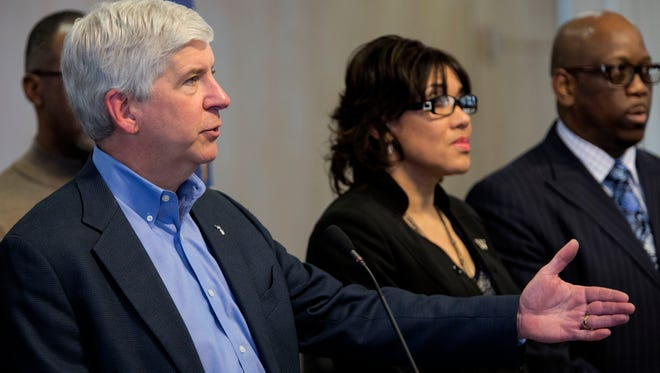 Gov. Rick Snyder listens and answers to questions from the press during the Flint water criss press conference on Monday, Jan. 11, 2016, at City Hall in Flint.