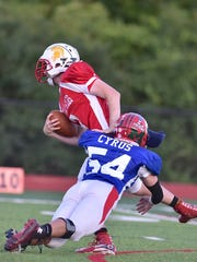 The East's Jacob Cyrus of New Richmond sacks the quarterback Thursday, June 8th at Kings High School 2017 SWOFCA East/West All-Star Football Game