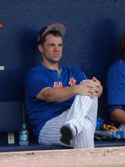 FILE - In this March 24, 2017, file photo, New York Mets third baseman David Wright (5) sits on the bench during a spring training baseball game against the Houston Astros, in Port St. Lucie, Fla. Mets captain David Wright won't participate in baseball activities for two months because of back and shoulder issues, another setback in his attempt to return from injuries that have sidelined him for two years,  and New York star outfielder Yoenis Cespedes is sidelined after hurting a wrist. New York made the announcements Tuesday, March 13, 2018, a day after Wright was examined by Dr. Robert Watkins in Los Angeles.(AP Photo/John Bazemore, File)