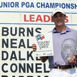 Sam Burns poses with the Jack Nicklaus trophy and an exception to the 2015 Valero Texas Open after winning the Junior PGA Championship August 1, 2014 at Miramont Country Club in Bryan, Texas.