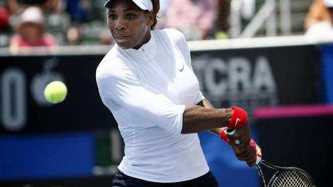 Serena Williams hits a return against Sweden's Sofia Arvidsson during the Fed Cup at the Delray Beach Tennis Center on April 21, 2013.