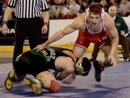 Ocean's Kyle Kiss looks to escape as he wrestles Camden
