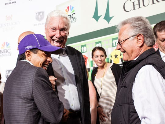 Jockey Victor Espinoza, Spendthrift Farms owner B. Wayne Hughes and trainer Art Sherman enjoy a lighter moment together at the conclusion of the drawing. Their horse California Chrome is the Derby favorite. April 30, 2014