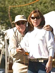 Fly casting authority Lefty Kreh gives pointers to Linda Schriner of Edgewater during a fly fishing event in Titusville several years ago.