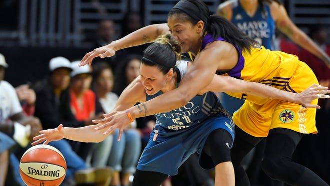 In this Oct. 16, 2016, file photo, Los Angeles Sparks forward Candace Parker, right, reaches in on Minnesota Lynx guard Anna Cruz during the second half in Game 4 of the WNBA Finals in Los Angeles. Last year's WNBA Finals were so good they're doing it all over again. The defending champion Los Angeles Sparks play the Minnesota Lynx, who are in the finals for the sixth time in the last seven years. Game 1 is on Sunday in Minneapolis.