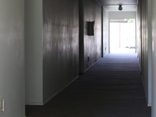 Curt Nelsen crawled down this hallway in his apartment building before his death.
