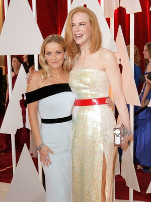 Reese Witherspoon, left, and Nicole Kidman arrive at the Oscars on Sunday, Feb. 22, 2015, at the Dolby Theatre in Los Angeles.