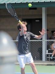 Abilene High's Max Owen reaches for a shot at the net