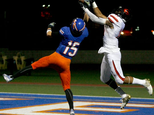 Westlake High defensive back Michael Carner (left) breaks up a pass intended for Grace Brethren wide receiver Noah Bean in the end zone on Friday night.