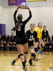 PCA's Jessica Paulson (No. 6) passes the ball to Abby