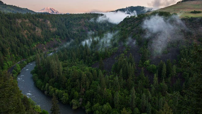 This May 6, 2016, photo shows the Klickitat River, a tributary of the Columbia River and Mt. Adams, top left, near Glenwood, Wash.