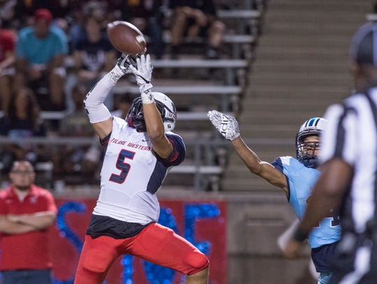 Tulare Western's Keshon Butler takes a long pass under