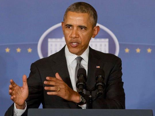 -Obama_Economy_WX104.jpg_20140310.jpg
