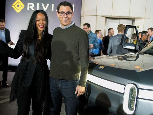 Rivian CEO and founder RJ Scaringe poses with singer
